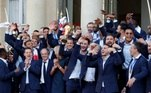 French President Emmanuel Macron and his wife Brigitte Macron pose with France soccer team captain Hugo Lloris holding the trophy, coach Didier Deschamps and players before a reception to honour the France soccer team at the Elysee Palace in Paris French President Emmanuel Macron and his wife Brigitte Macron pose with France soccer team captain Hugo Lloris holding the trophy, coach Didier Deschamps and players before a reception to honour the France soccer team after their victory in the 2018 Russia Soccer World Cup, at the Elysee Palace in Paris, France, July 16, 2018. REUTERS/Philippe Wojazer