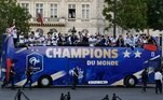 France's national soccer team players celebrate with teammates on the roof of a bus while parading down the Champs-Elysee avenue in Paris France's national soccer team players take pictures with their mobile phones as they celebrate with teammates and the trophy on the roof of a bus while parading down the Champs-Elysee avenue after winning the Russia 2018 World Cup final football match, in Paris, France July 16, 2018. Eric Feferberg/Pool via Reuters