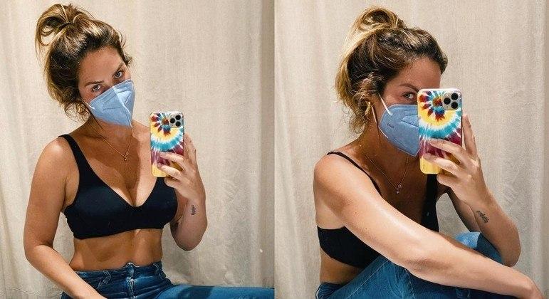 Giovanna Ewbank posou com look básico em chão de provador de roupas