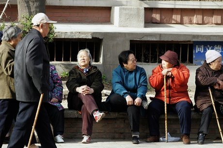 A China é um dos países que adotam sistema semelhante em parte para atender às demandas do envelhecimento da população