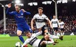 London (United Kingdom), 03/03/2019.- Chelsea's Gonzalo Higuain (L) in action against Fulham's Joe Bryan (C) during the English Premier League soccer match between Fulham FC and Chelsea FC at Craven Cottage in London, Britain, 03 March 2019. (Londres) EFE/EPA/FACUNDO ARRIZABALAGA EDITORIAL USE ONLY. No use with unauthorized audio, video, data, fixture lists, club/league logos or 'live' services. Online in-match use limited to 120 images, no video emulation. No use in betting, games or single club/league/player publications.