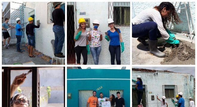 Imagem mostra voluntários trabalhando em reforma de casas em Natal