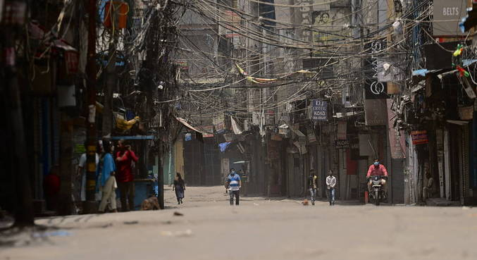 Nova Déli flexibiliza medidas de confinamento contra covid-19