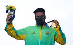 Gold medallist Italo Ferreira of Brazil wearing a protective face mask celebrates on the podium REUTERS/Lisi Niesner