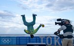 Brazil's Italo Ferreira, Gold medalist, celebrates on the podium at the Tsurigasaki Surfing Beach, in Chiba, on July 27, 2021 during the Tokyo 2020 Olympic Games. Olivier MORIN / AFP / POOL