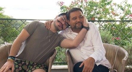 João, filho do Geraldo Luís, com o pai
