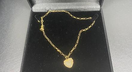 Cordão de ouro com coração era presente para esposa