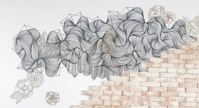 Uma das paredes pintadas pela artista
