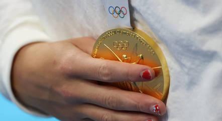 Katie carregou medalhas como quem cuida de um bebê