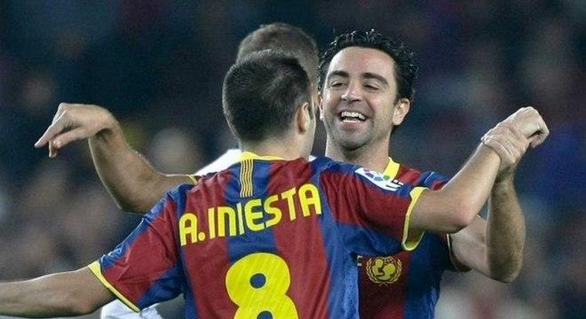 Iniesta e Xavi fizeram história com a camisa do Barcelona