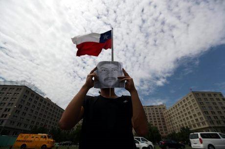 Protestos com rosto de líder tomaram capital Santiago