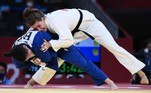 Germany's Anna-Maria Wagner (white) and Brazil's Mayra Aguiar compete in the judo women's -78kg quarterfinal bout during the Tokyo 2020 Olympic Games at the Nippon Budokan in Tokyo on July 29, 2021. Franck FIFE / AFP