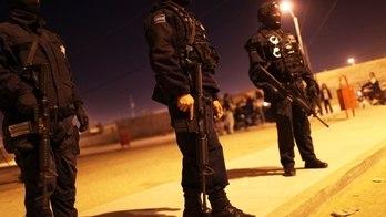__Policiais são detidos por suspeita de assassinato de político__ (Reprodução)