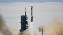 Missão tripulada se acopla à estação espacial chinesa