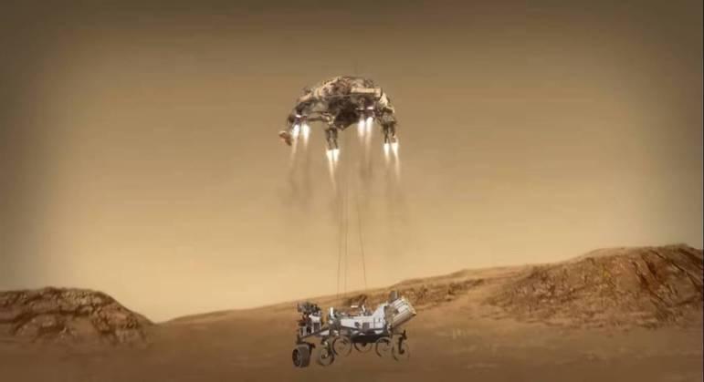 Rover e helicóptero desceram em direção ao solo pendurados por um cabo de nylon