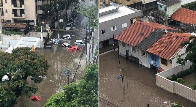 Carros ficam presos em alagamento na rua Ibijaú, em Moema
