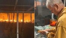 Morador descasca cenouras a poucos metros de incêndioviolento