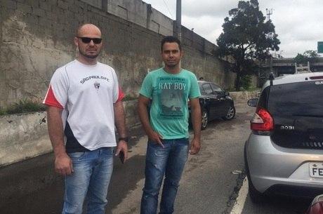 Edmar (à esq.) e Isaías (à dir.) ficaram presos devido aos alagamentos na Marginal Tietê