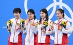 Gold medallist China's Li Bingjie, China's Yang Junxuan, China's Tang Muhan and China's Zhang Yufei pose with their medals after they set a new World Record in the final of the women's 4x200m freestyle relay swimming event during the Tokyo 2020 Olympic Games