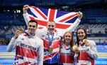 From Left, Gold medallists Britain's James Guy, Britain's Adam Peaty, and Britain's Anna Hopkin and Britain's Kathleen Dawson pose with their medals at the side of the pool after the final of the mixed 4x100m medley relay swimming event during the Tokyo 2020 Olympic Games at the Tokyo Aquatics Centre in Tokyo on July 31, 2021.