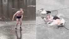 Gelo racha e patinador seminu mergulha de cara em água a-20ºC