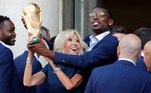 Brigitte Macron, the wife of French President Emmanuel Macron, and player Paul Pogba hold the trophy before a reception to honour the France soccer team after their victory in the 2018 Russia Soccer World Cup, at the Elysee Palace in Paris Brigitte Macron, the wife of French President Emmanuel Macron (not pictured), and player Paul Pogba hold the trophy before a reception to honour the France soccer team after their victory in the 2018 Russia Soccer World Cup, at the Elysee Palace in Paris, France, July 16, 2018. REUTERS/Philippe Wojazer