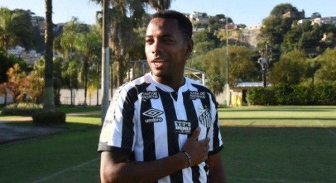 Robinho já tinha até mesmo posado com a camisa do Santos