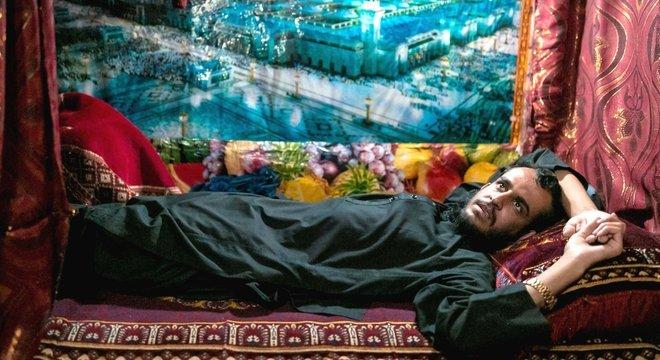 Um poster de Medina em uma cela na prisão Pul-e-Charkhi