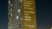 Declarações de amor e alertas de violência iluminam prédio de BH