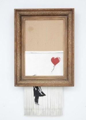 Quadro parcialmente rasgado do artista britânico Banksy foi leiloado