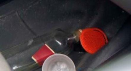 Havia garrafa de bebida dentro do veículo