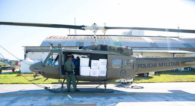 Helicópteros da PM e da Polícia Civil vão ajudar na distribuição de doses