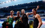 Australia's Emma Mckeon, Australia's Bronte Campbell, Australia's Cate Campbell, and Australia's Meg Harris celebrate after winning the final of the women's 4x100m freestyle relay swimming event during the Tokyo 2020 Olympic Games at the Tokyo Aquatics Centre in Tokyo on July 25, 2021. Odd ANDERSEN / AFP