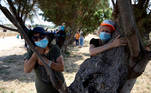 People take part in a campaign by Israel's Nature and Parks Authority calling on Israelis to join sightseeing tours and find comfort in tree hugging amid a spike in the coronavirus disease (COVID-19), in Apollonia National Park, near Herzliya, Israel July 7, 2020. Picture taken July 7, 2020. REUTERS/Ronen Zvulun TPX IMAGES OF THE DAY