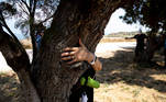 People take part in a campaign by Israel's Nature and Parks Authority calling on Israelis to join sightseeing tours and find comfort in tree hugging amid a spike in the coronavirus disease (COVID-19), in Apollonia National Park, near Herzliya, Israel July 7, 2020. Picture taken July 7, 2020. REUTERS/Ronen Zvulun