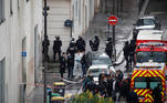 Police officers investigate the scene of an incident near the former offices of French magazine Charlie Hebdo, in Paris, France September 25, 2020. REUTERS/Gonzalo Fuentes