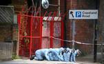 Forensic officers work at the area after Sasha Johnson, a Black Lives Matter activist, was shot in an early morning attack near her home in Peckham, London, Britain, May 24, 2021. REUTERS/Hannah McKay TPX IMAGES OF THE DAY