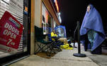Shoppers wait in line eight hours prior to the opening, in hopes of Black Friday savings, at a computer game store in La Grange, Kentucky, U.S. November 26, 2020. REUTERS/Bryan Woolston TPX IMAGES OF THE DAY
