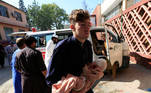A man carries an injured child at a hospital after a truck bomb blast, in Jalalabad, Afghanistan October 3, 2020. REUTERS/Parwiz