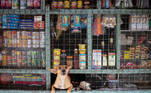 A dog peeks out from a sundries store in Tondo, Manila, Philippines, October 6, 2020. REUTERS/Eloisa Lopez TPX IMAGES OF THE DAY