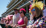 Fans watch a horse race at Churchill Down on the day before the running of 147th Kentucky Derby in Louisville, Kentucky, U.S. April 30, 2021. REUTERS/Bryan Woolston