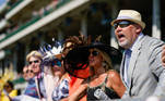 Spectators at Churchill Downs cheer during the first race on the day of the running of 147th Kentucky Derby in Louisville, Kentucky, U.S. May 1, 2021. REUTERS/Bryan Woolston