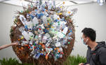 A visitor views a display made from recycled plastic bottles during the final day of the Chelsea Flower Show, delayed from its usual spring dates because of the lockdown restrictions amid the spread of the coronavirus disease (COVID-19) pandemic in London, Britain, September 26, 2021. REUTERS/Henry Nicholls