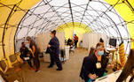 St Mary Medical Center staff work inside a triage tent to handle the overflow at its 200 bed hospital during the outbreak of the coronavirus disease (COVID-19) in Apple Valley, California, U.S., December 8, 2020. REUTERS/Mike Blake TPX IMAGES OF THE DAY
