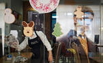 Workers clean at a restaurant inside a department store, after the Thai government ordered a temporary closure of various public facilities, amid the spread of the coronavirus disease (COVID-19), in Bangkok, Thailand January 2, 2021. REUTERS/Athit Perawongmetha