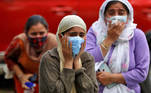 Relatives of a man who died from the coronavirus disease (COVID-19) mourn during his cremation at a crematorium ground in Srinagar May 25, 2021. REUTERS/Danish Ismail TPX IMAGES OF THE DAY