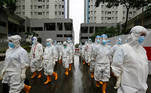 Healthcare workers wearing personal protective equipment (PPE) prepare to treat patients at the emergency hospital for coronavirus disease (COVID-19) in Athletes Village, Jakarta, Indonesia January 26, 2021. REUTERS/Ajeng Dinar Ulfiana TPX IMAGES OF THE DAY