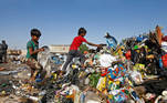Iraqi boys collect recyclable garbage at a dump, amid the spread of the coronavirus disease (COVID-19), in the holy city of Najaf, Iraq October 23, 2020. Picture taken October 23, 2020. REUTERS/Alaa Al-Marjani