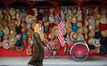 A woman wearing a protective mask walks past a souvenir shop, amid the coronavirus disease (COVID-19) outbreak in Kuala Lumpur, Malaysia January 12, 2021. REUTERS/Lim Huey Teng