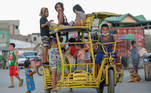 Children ride on a pedicab at a park in Baseco compound, Manila, Philippines, December 16, 2020. REUTERS/Lisa Marie David